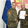 Members of the Mobile Joint Training Team receive letters of commendation from JFC Naples Senior Enlisted Leader
